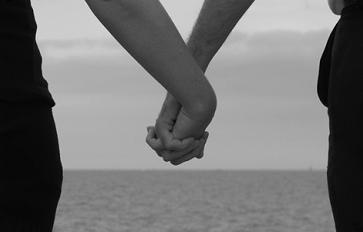 Black and white image of couples holding hands